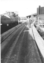 Image of Hooker chemical tank and car and mill employee (.038)