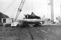 Image of Log yard American carane unloading Dodge 1964 (.064)