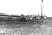 Image of Cat dozer cleaning up yard 1959 (.008)