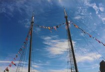 Image of Wawona masts decorated with flags