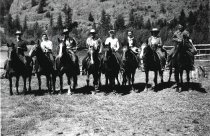 Image of Bill and Annett Bessner with 6 other people on horses