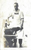 Image of Unidentified man preparing to a slice fish.