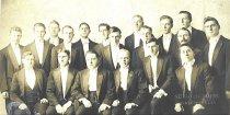 Image of Nineteen men in formal attire.