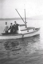 """Image of Bill Lowman, Uncle Hubert, & Aunt Fanny Perry aboard the """"Betty"""""""