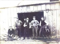 Image of Seven men outside warehouse