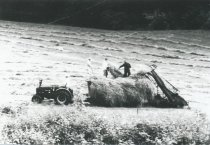 Image of Loading hay with hay loader.