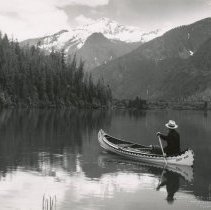 Image of Man canoeing on Baker Lake, view of Eagle Peak