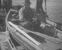 Image of Unidentified man in rowboat