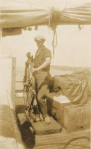 Image of D.XX.003.030 - Man at the wheel of a boat
