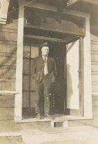 Image of Unknown man in doorway