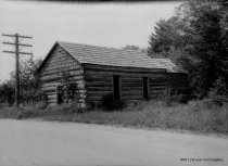 Image of Log cabin at unknown location