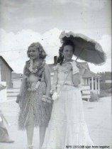 Image of Children's Parade - parasol girl and hula dancer