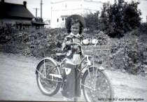 Image of Kiddies' Parade - cowgirl on decorated bicycle