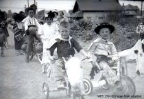 Image of Kiddies' Parade - cowboys on tricycles