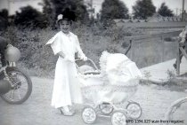 Image of Kiddies' Parade - girl with decorated buggy
