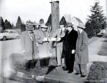 Image of Kiwanis Club installing a street sign
