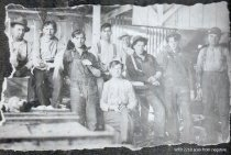 Image of Men on porch in work clothes