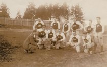 Image of 1936 football team, coach Chester V. Rhodes