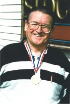 Image of WF 6044 - Wallie Funk with Don Hume's Olympic gold medal