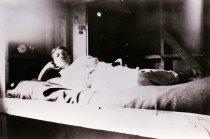 Image of 2001.048.009 - Frank Castiglia on his bunk