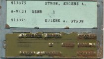 Image of US Navy identification name plate for Eugene A. Strom