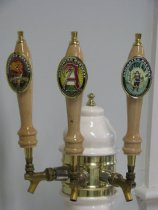 Image of Anacortes Brewhouse tower (1994) with three brewery tap handles