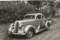 Image of 2012.098.060 - Olga Amala in 1936 Dodge coupe