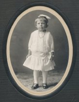 Image of 2012.098.176 - young girl is a white dress