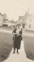 Image of 2012.098.234 - woman with umbrella and hat