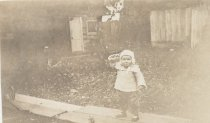 Image of 2012.098.242 - child in white hat and  jacket