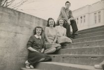 Image of four students on staircase