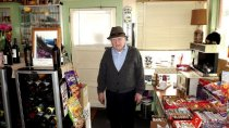 Image of 2014.064.002-.003 - Mr. Caufield at Lake Erie Grocery
