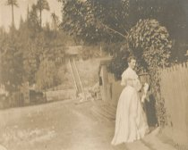 Image of Cora Allmond outside in long white dress