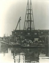 Image of pile driver, capping scow, tug  R.E.F.