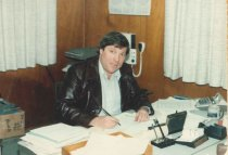 Image of unidentified man in cannery office