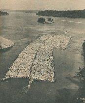 Image of log raft leaving Deception Pass