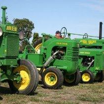 Image of 2015.059.022.039-.041 - five John Deere tractors