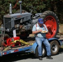 Image of 2015.059.022.043 - Case tractor on a trailer