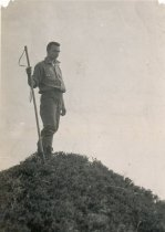 Image of man on top of Mt. How