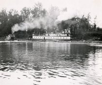 Image of W.T. PRESTON working on a river