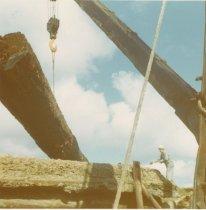 Image of D.XXV.168.001 - W.T. PRESTON lifting a log
