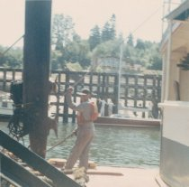 Image of crewman on the bow of the W.T. PRESTON