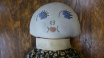 Image of Fabric doll embroidered face