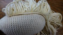 Image of Crocheted doll back of head and hair attachment