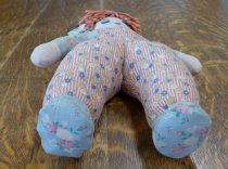 Image of Feet of handmade cloth and yarn doll