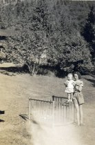 Image of girl and toddler in park