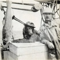 Image of Man and dog on boat
