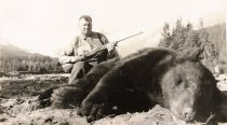 Image of Paul Satko with dead bear