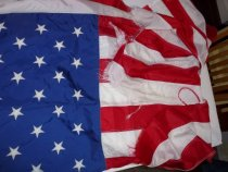 Image of 50 star flag showing tattered end