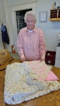 Image of Bernice Pratt and bed spread